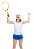 Tennis player with racket rejoicing in success Stock Photography