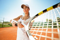 Tennis player with racquet expecting a ball Royalty Free Stock Photo