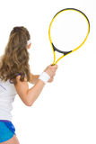 Tennis player ready to hit ball. rear view Stock Photo