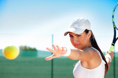 Tennis player ready to hit ball. Young female tennis player ready to hit ball Royalty Free Stock Images