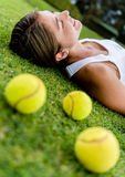 Tennis player relaxing outdoors Royalty Free Stock Image