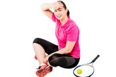 Tennis player resting after a workout, and wipes the sweat royalty free stock image