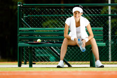 Tennis player rests at the bench Stock Photo