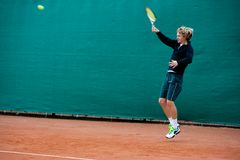 Tennis player. S jump before hitting the ball Royalty Free Stock Photos
