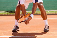 Tennis player's legs. In position for waiting tennis ball Stock Images