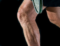 Tennis player's legs Royalty Free Stock Photo