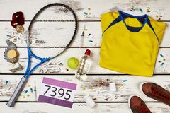 Tennis player`s uniform and racquet Royalty Free Stock Photography