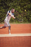 Tennis player serving ball Royalty Free Stock Images