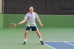 Tennis player setting up open stance forehand. Royalty Free Stock Images