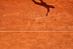 Tennis player shadow in action Stock Photo
