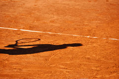 Tennis player shadow on a clay tennis court Stock Images