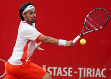 Tennis player shot effort. Fabio Fognini pictured in action during the match against Marcos Baghdatis counting for BRD Nastase-Tiriac Trophy Stock Photography