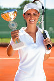 Tennis player showing golden goblet Royalty Free Stock Photography