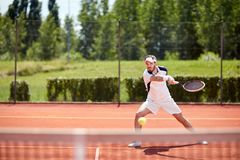 Tennis player smash ball. On tennis court stock photography
