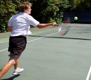 Tennis Player smashing a ball. Across court Stock Image