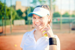 Tennis player, sportswoman on tennis court wearing fitness outfit and training for match. Modern lifestyle concept, tennis player Royalty Free Stock Images