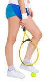 Tennis player standing with one foot on ball Stock Photo