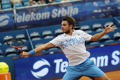 Tennis player Stanislas Wawrinka returns the ball during tennis match. Belgrade, Serbia - May 5, 2010: Tennis player Stanislas Wawrinka returns the ball during Royalty Free Stock Photo