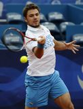 Tennis player Stanislas Wawrinka returns the ball during tennis match. Belgrade, Serbia - May 5, 2010: Tennis player Stanislas Wawrinka returns the ball during Royalty Free Stock Images