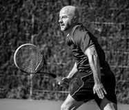 Tennis player. Striving in a match Stock Images