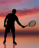 Tennis Player on Sunset Background Stock Images