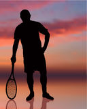 Tennis Player on Sunset Background Royalty Free Stock Image