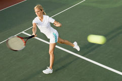 Tennis Player Swinging Racket in Forehand Motion Stock Images