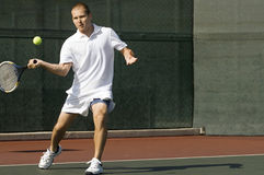 Tennis Player Swinging Racket in Forehand Motion Stock Photography