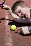 Tennis Player Tantrum. Tennis Player Throws A Dummy Spit Over An Umpires Line Ball Decision Stock Photography