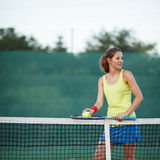 Tennis player on the tennis court Royalty Free Stock Images
