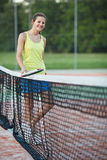 Tennis player on the tennis court Stock Photography