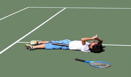 Tennis Player. Tired on the court stock photography