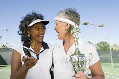 Tennis Player With Trophy Holding Cell Phone Stock Photo