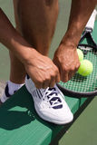 Tennis Player Tying Shoe-Vertical Stock Photos