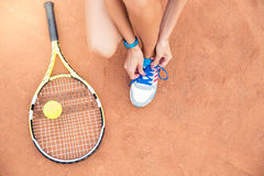Tennis player tying shoelaces Royalty Free Stock Images