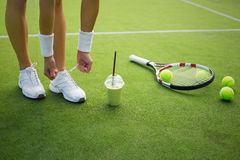 Tennis player tying shoes. In court stock photos