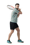 Tennis player waiting to hit ball holding racket with both hands in backhand pose Royalty Free Stock Images