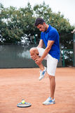 Tennis player warm-up outdoors Royalty Free Stock Photography