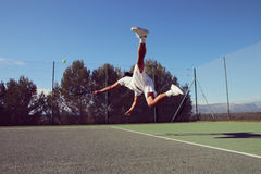 Tennis player who dives. Tennis player dives to catch a ball Stock Images
