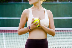 Tennis player. Woman with tennis balls on the court Royalty Free Stock Image