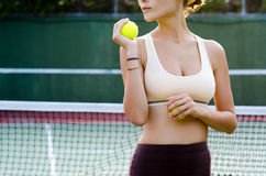 Tennis player. Woman with tennis balls on the court Royalty Free Stock Images