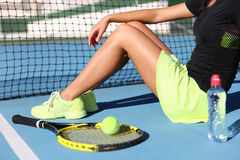 Tennis player woman resting drinking water Royalty Free Stock Images