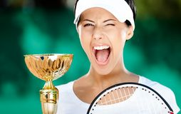 Tennis player won the match. Tennis player won the cup at the sport tournament. Victory Stock Image
