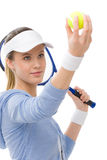 Tennis player - young woman holding racket. Tennis player - young woman with racket in fitness outfit Stock Photo