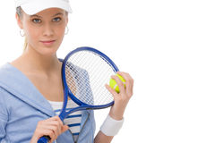 Tennis player - young woman holding racket Royalty Free Stock Photos