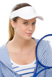 Tennis player - young woman holding racket Royalty Free Stock Images