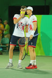 Tennis players Andy Murray R and Jamie Murray of Great Britain in action during men`s doubles first round match of the Rio 2016 Stock Photo