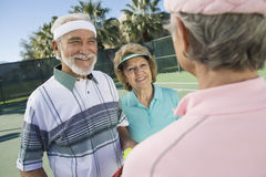 Tennis Players Chatting On Court Royalty Free Stock Image