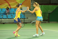 Tennis players Elina Svitolina L and Olga Savchuk of Ukraine in action during doubles first round match of the Rio 2016 Olympics Royalty Free Stock Photos