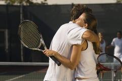 Tennis Players Embracing Stock Photo